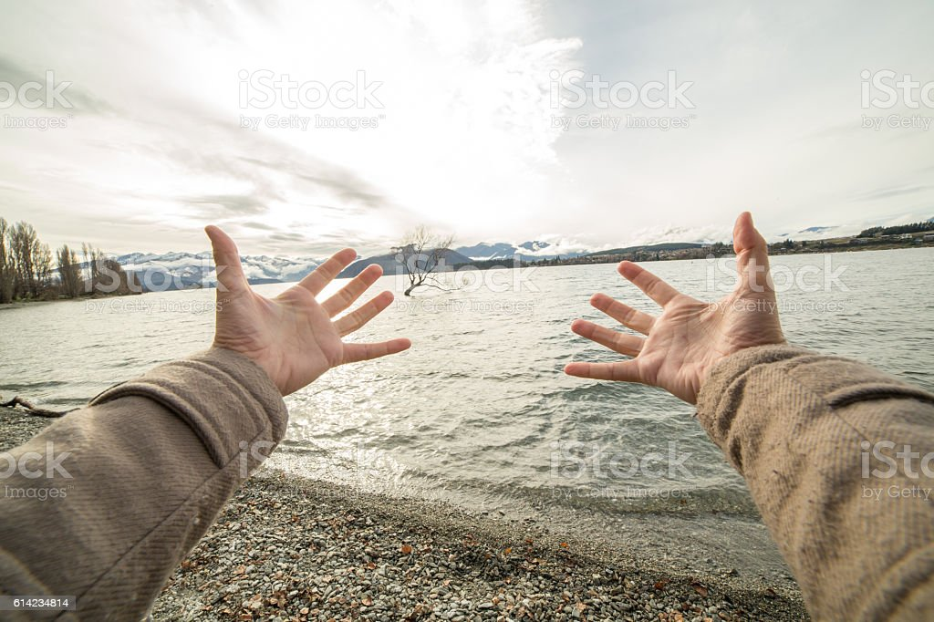 Personal perspective of person embracing nature stock photo