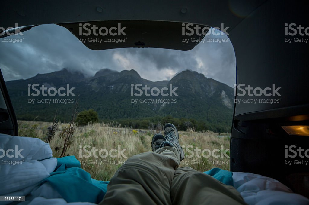 Personal perspective of a person lying in a car\'s trunk looking...