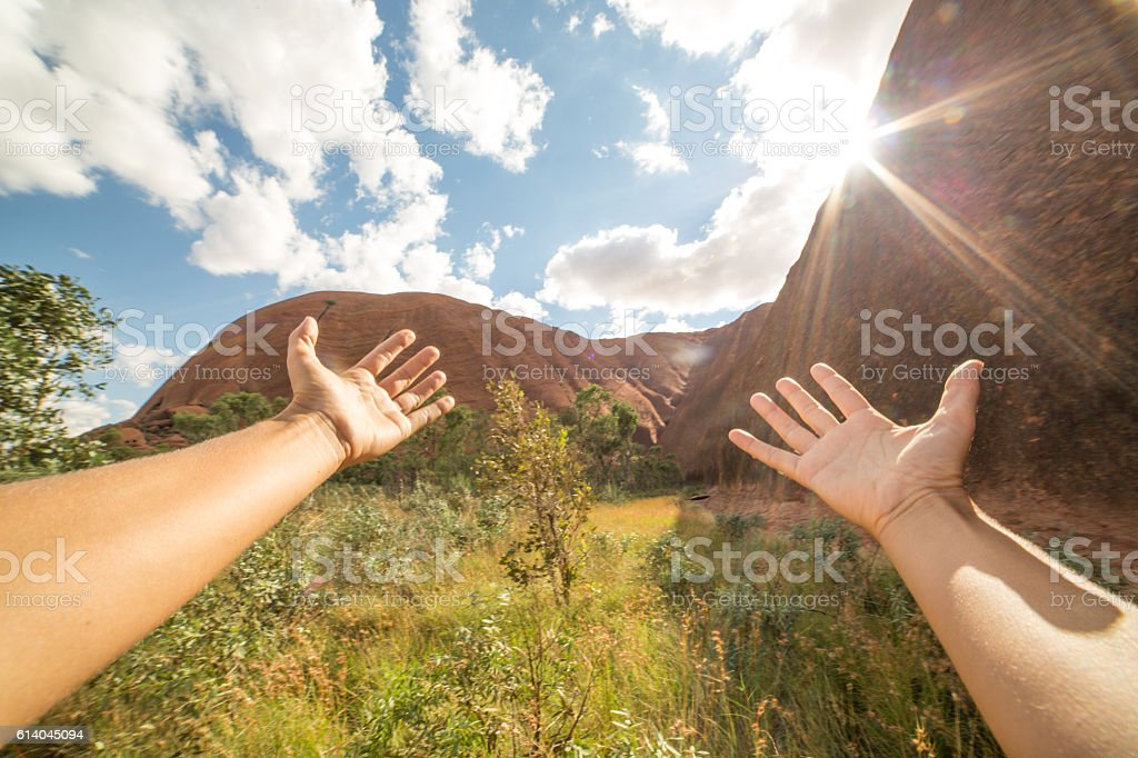 Personal perspective of woman embracing nature stock photo