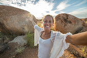 Personal perspective of woman visiting Devil's Marbles, Australia