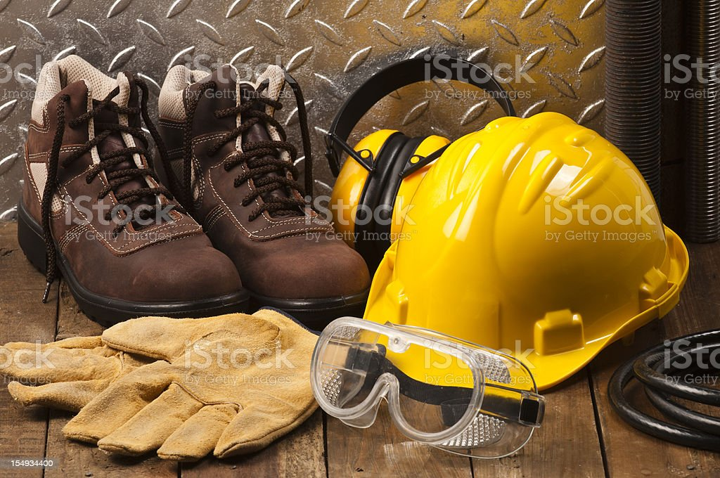 Personal protective workwear on the floor stock photo