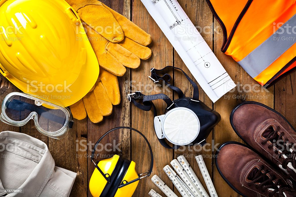 Personal safety workwear and construction blueprint shot directly above stock photo