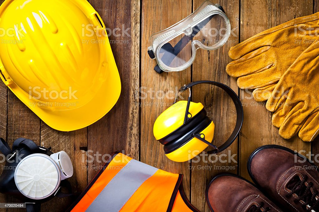 Personal safety workwear on rustic wood background shot directly above stock photo