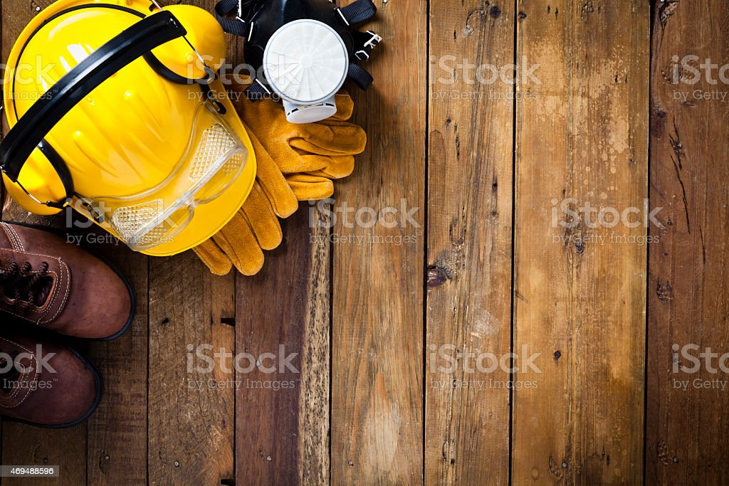 Personal safety workwear on rustic wood table stock photo