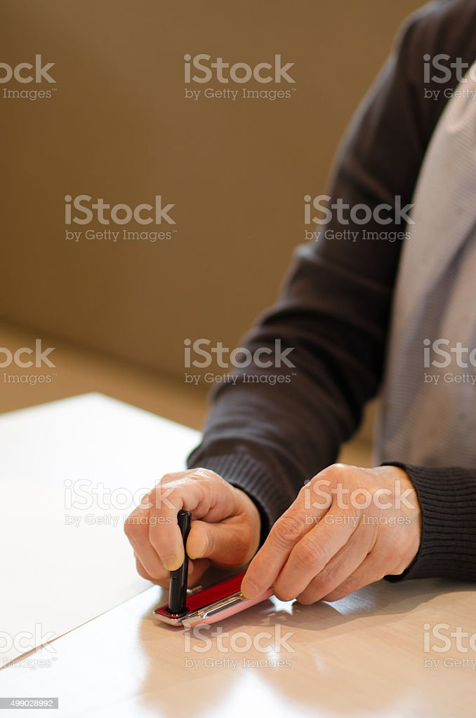 personal seal and hands stock photo
