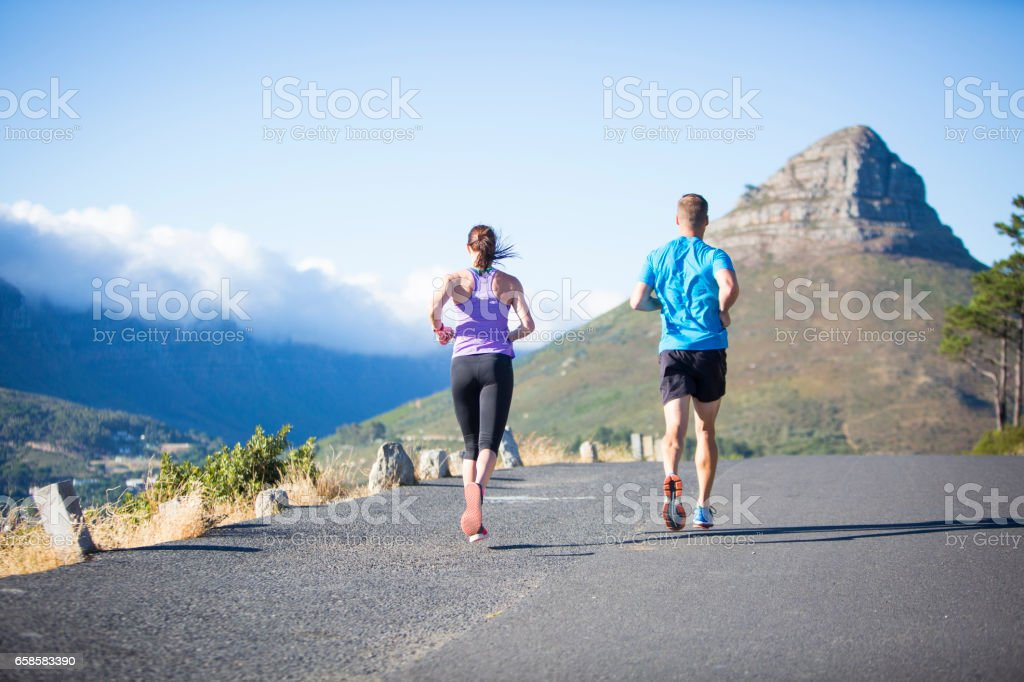 Personal Trainer and his female athlete out on a run together stock photo