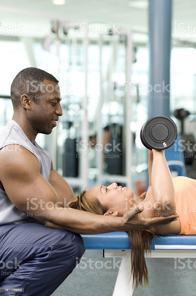 Personal Trainer and Weightlifter royalty-free stock photo