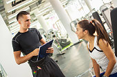 Personal trainer explaining exercise results to his female client.