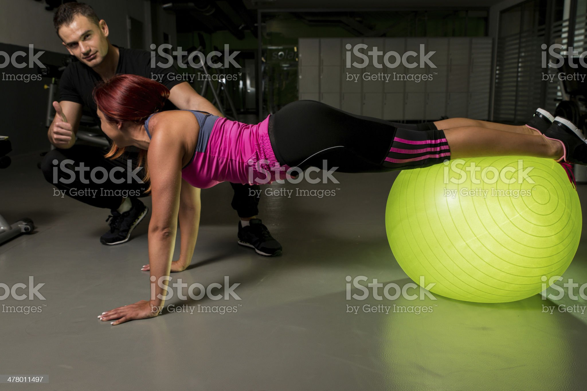 Personal trainer hold thumb up royalty-free stock photo