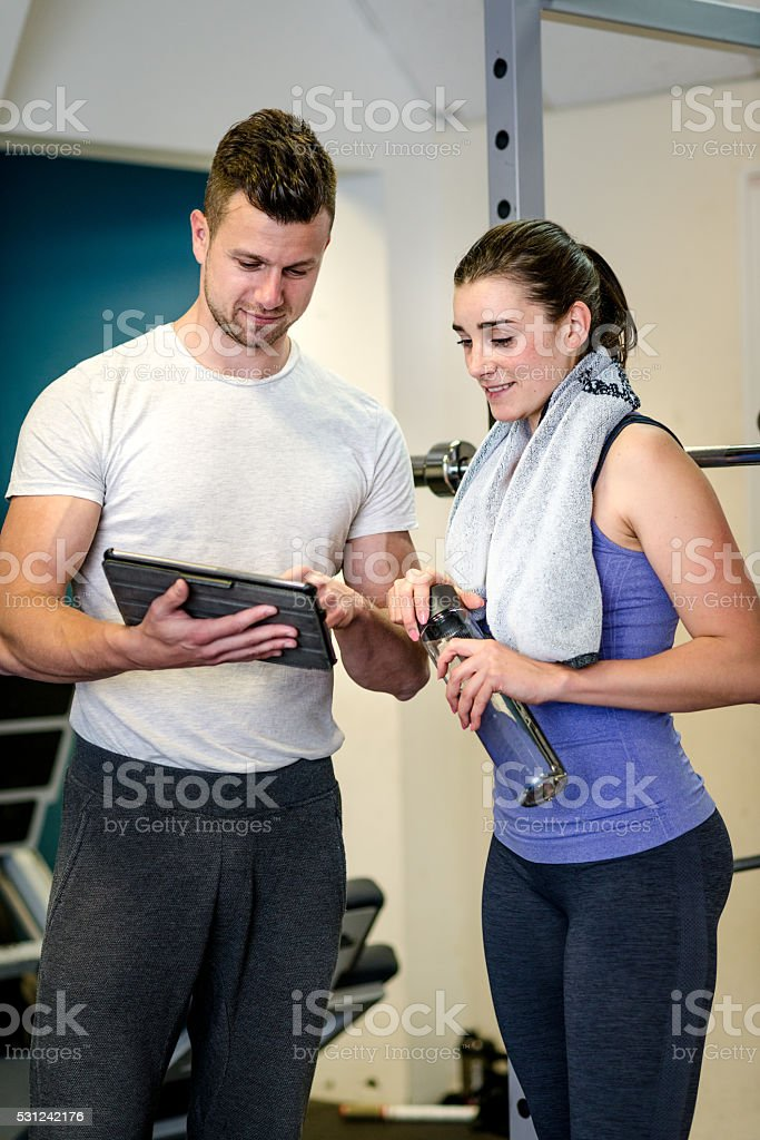 Personal trainer showing her result of workout stock photo