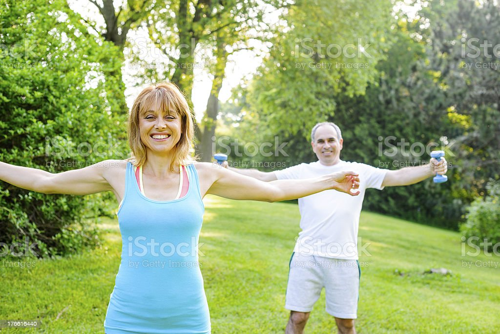 Personal trainer with client exercising outside royalty-free stock photo