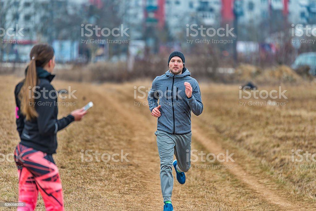 Personal trainer with stopwatch stock photo