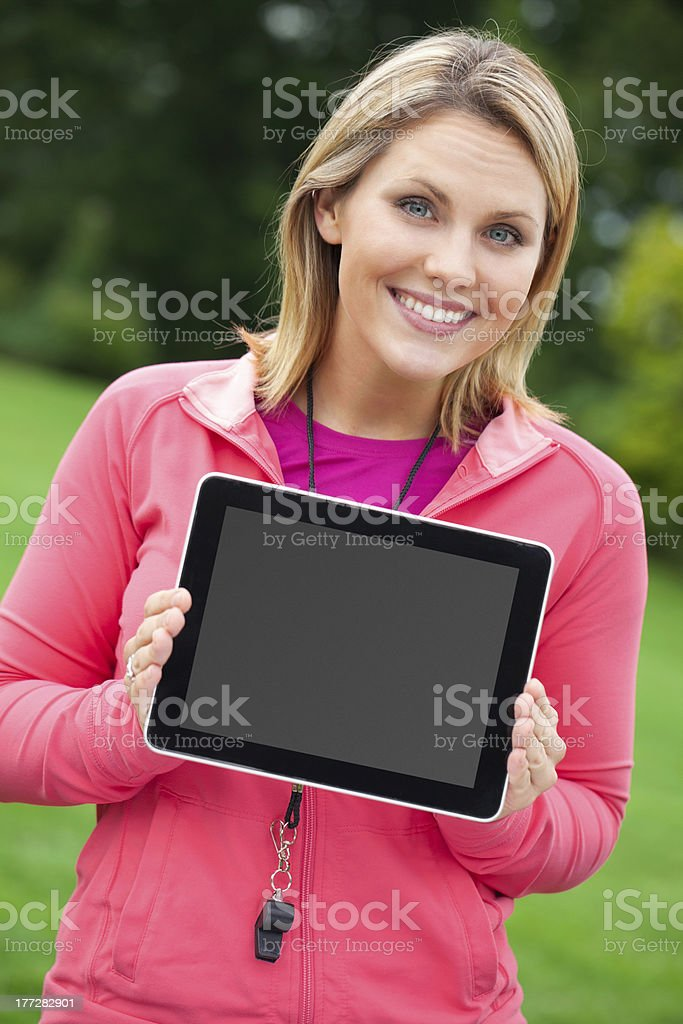 Personal trainer with table PC royalty-free stock photo