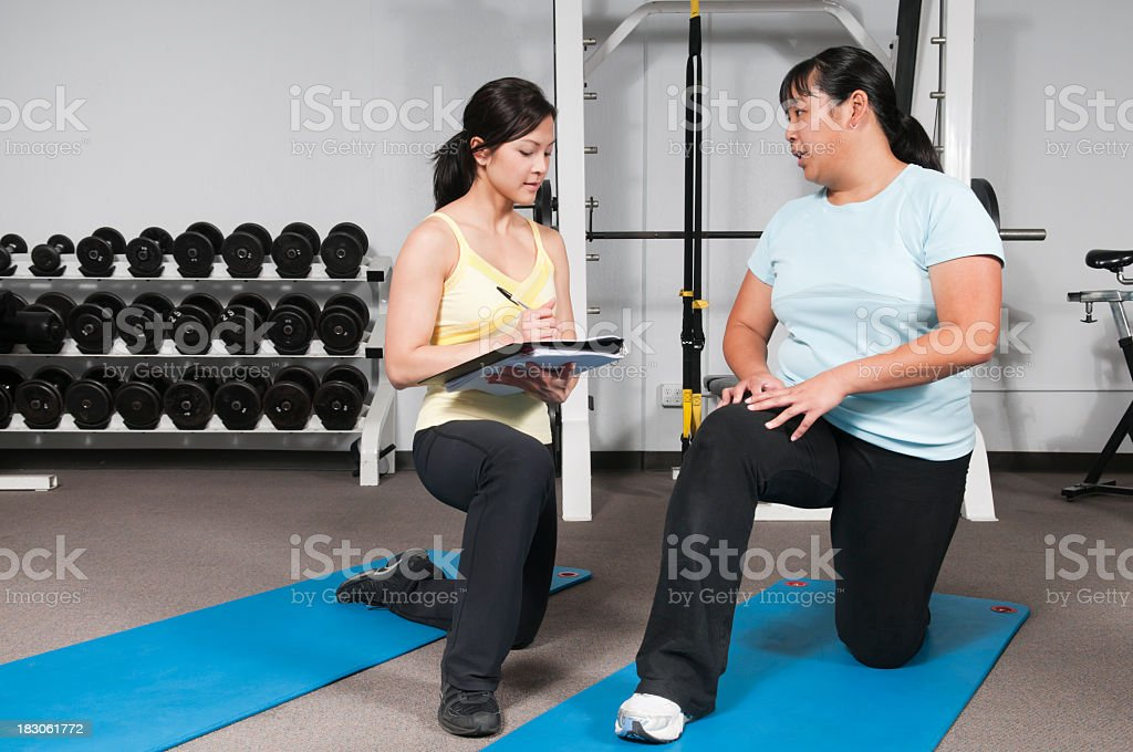 Personal Trainer Working With Client royalty-free stock photo