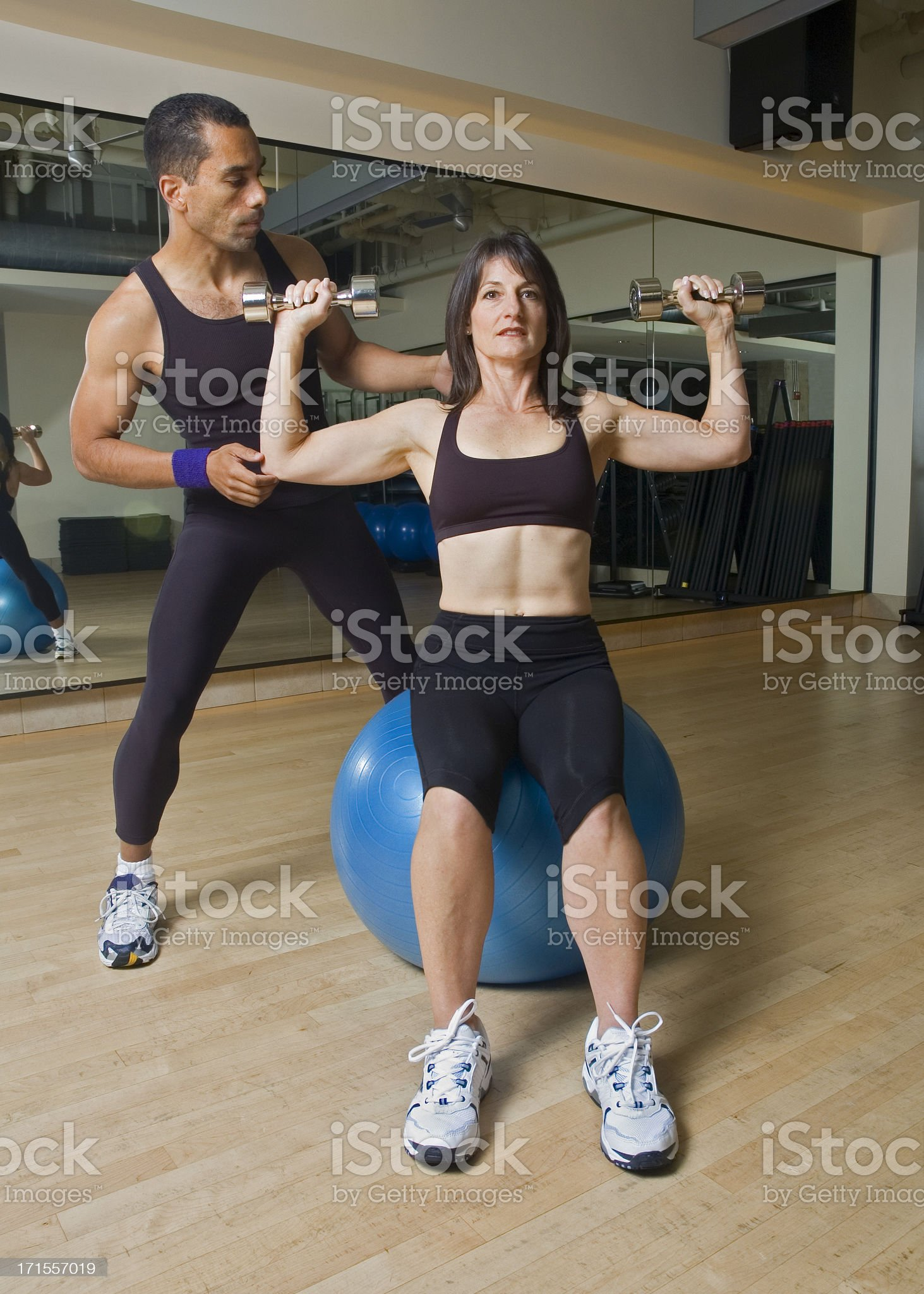 Personal Trainer Workout with Exercise Ball royalty-free stock photo