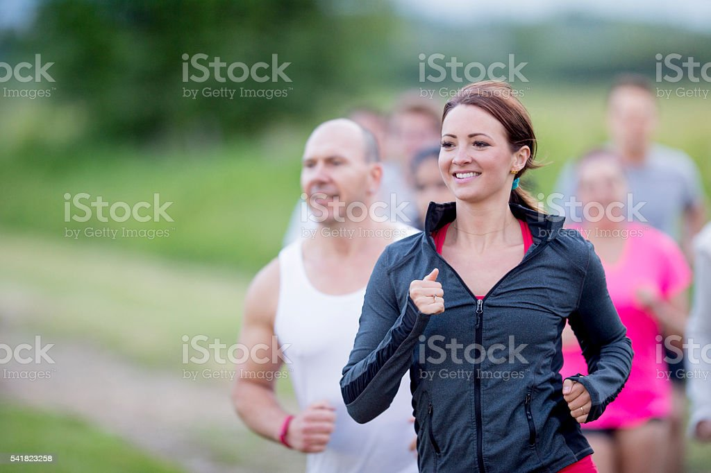 Personal Trainers Leading a Run stock photo