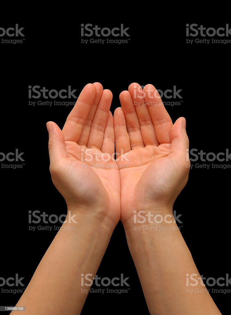 A person's hands in a cupping gesture royalty-free stock photo