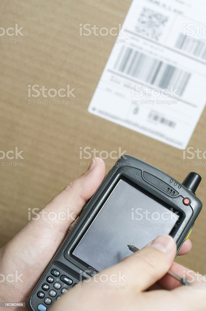 Person's Hands Taking Inventory with Barcode Scanner PDA Computer stock photo