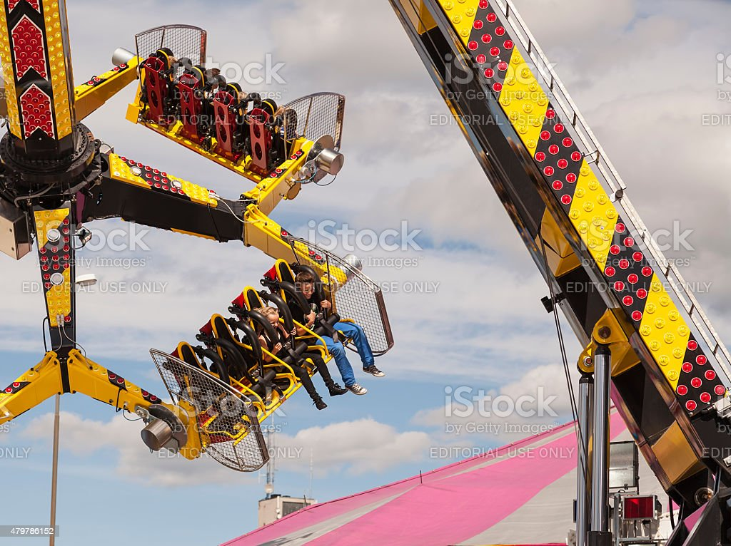 Persons in a ride at an amusement park stock photo