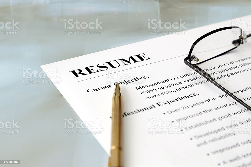 A person's resume spectacles and pencil on a table stock photo
