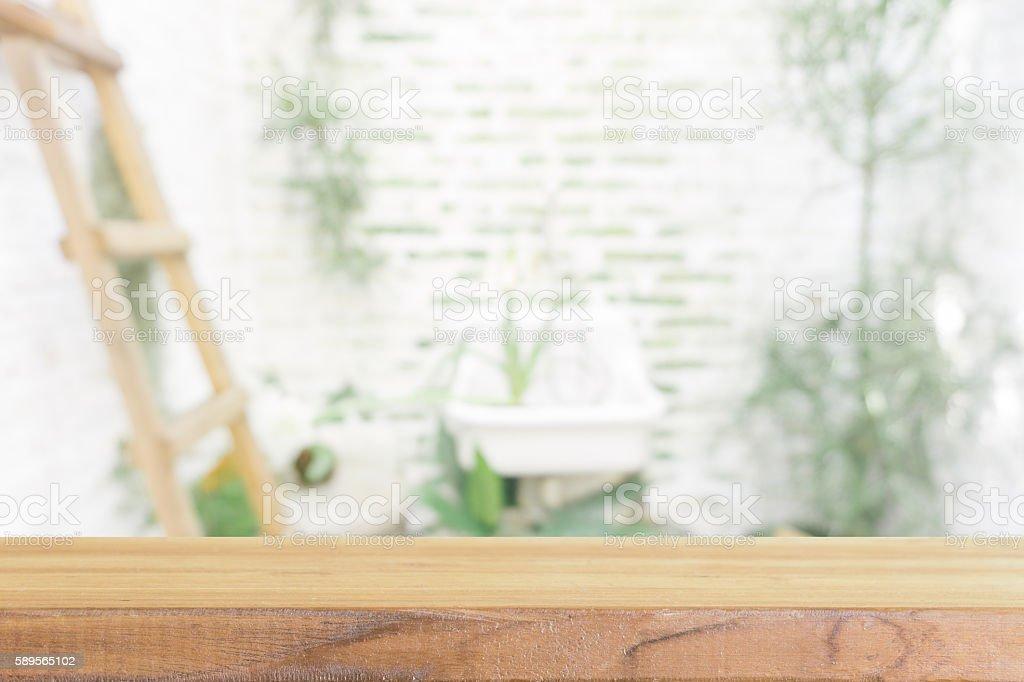 Perspective brown wood over blur men toilet in restaurant. stock photo