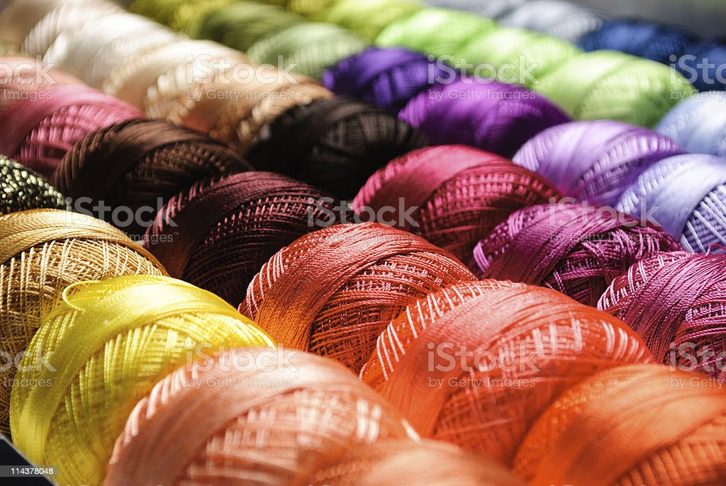 Perspective image of a series of vivid color threads stock photo