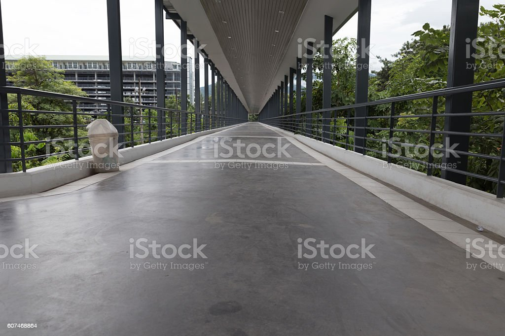 perspective of elevated pedestrian walkway stock photo