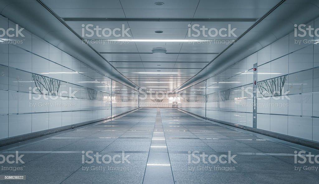 Perspective of Empty underground passage at night stock photo