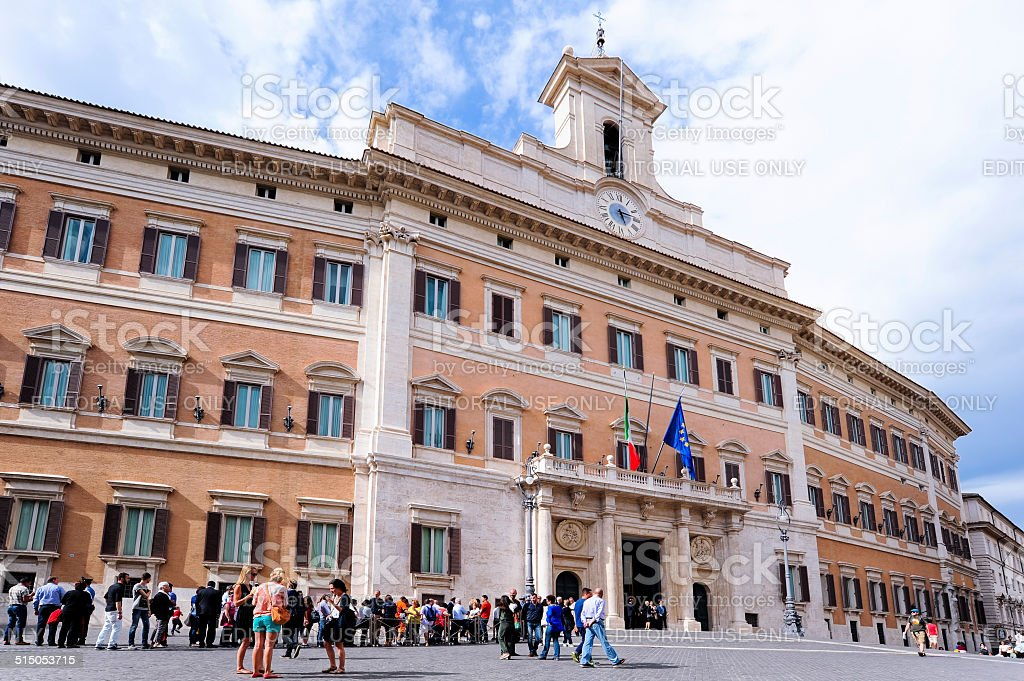 Perspective of Montecitorio in Rome during the day with visitors stock photo
