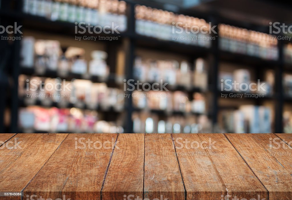 Perspective top wooden table with blurred cafe background stock photo