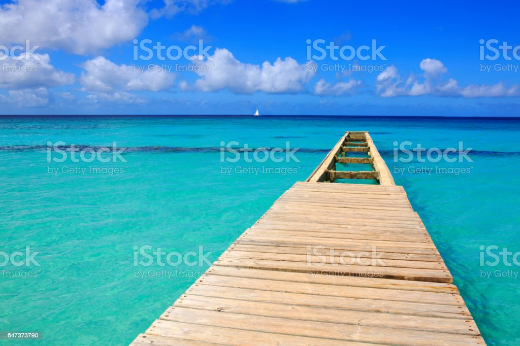 Perspective view of a wooden pier on the caribbean sea stock photo