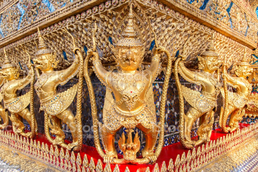 Perspective view of golden religious statue (Statue Garuda) in wat phra kaew temple, Bangkok, Thailand. stock photo