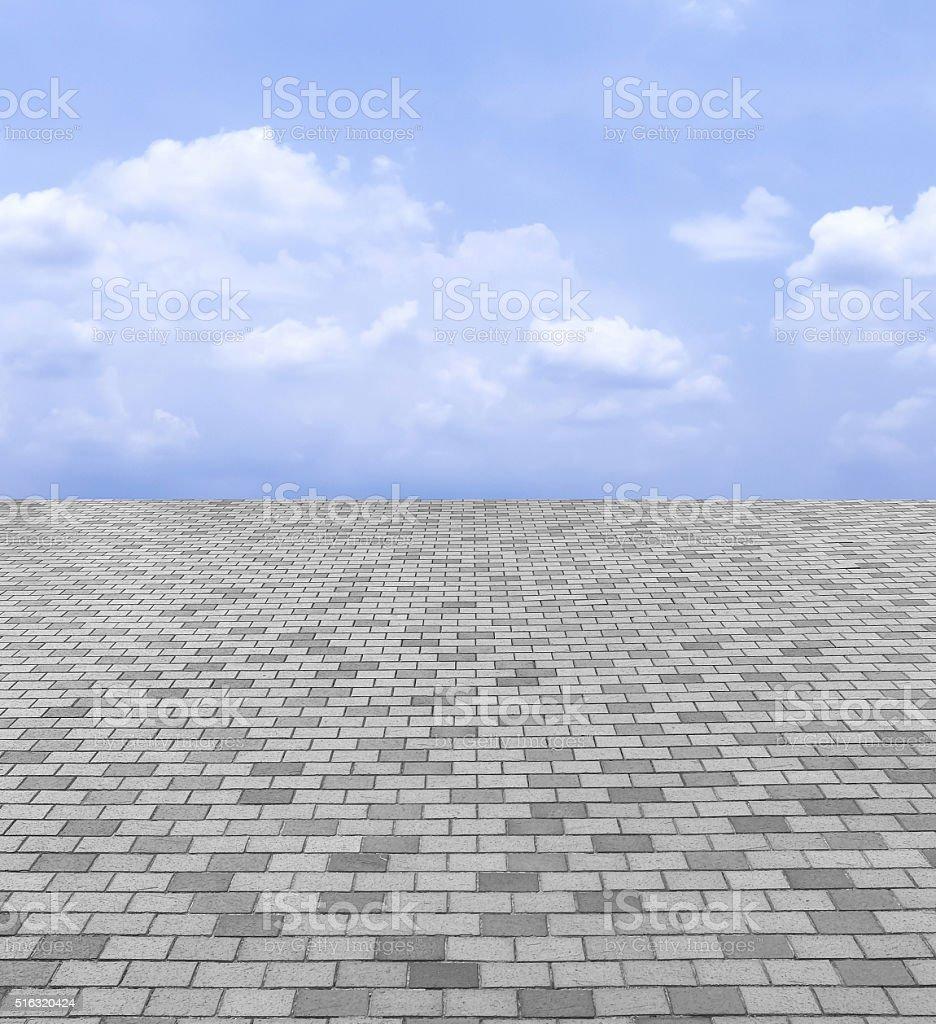 Perspective View of Monotone Gray Brick Stone Street Road. Sidewalk stock photo
