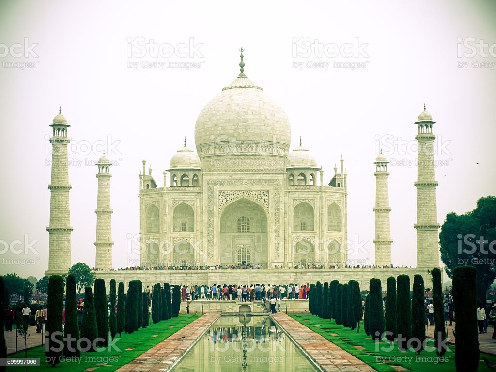 Perspective view on Taj-Mahal mausoleum with reflection in water. stock photo
