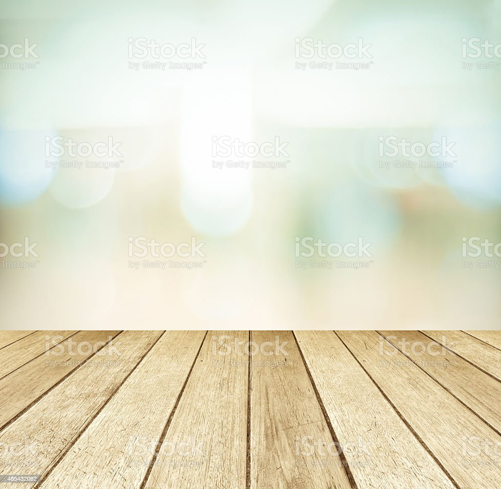 Perspective wood and blurred store with bokeh background stock photo