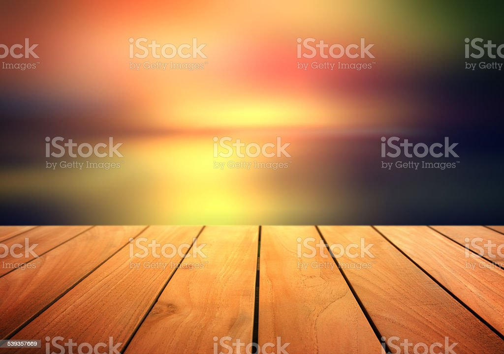 Perspective wood and colorful blurred background stock photo