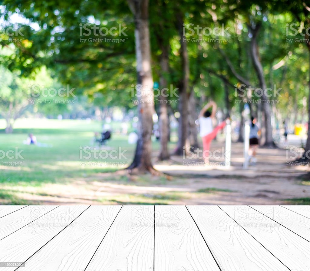 Perspective wood with blurred people activities in park stock photo