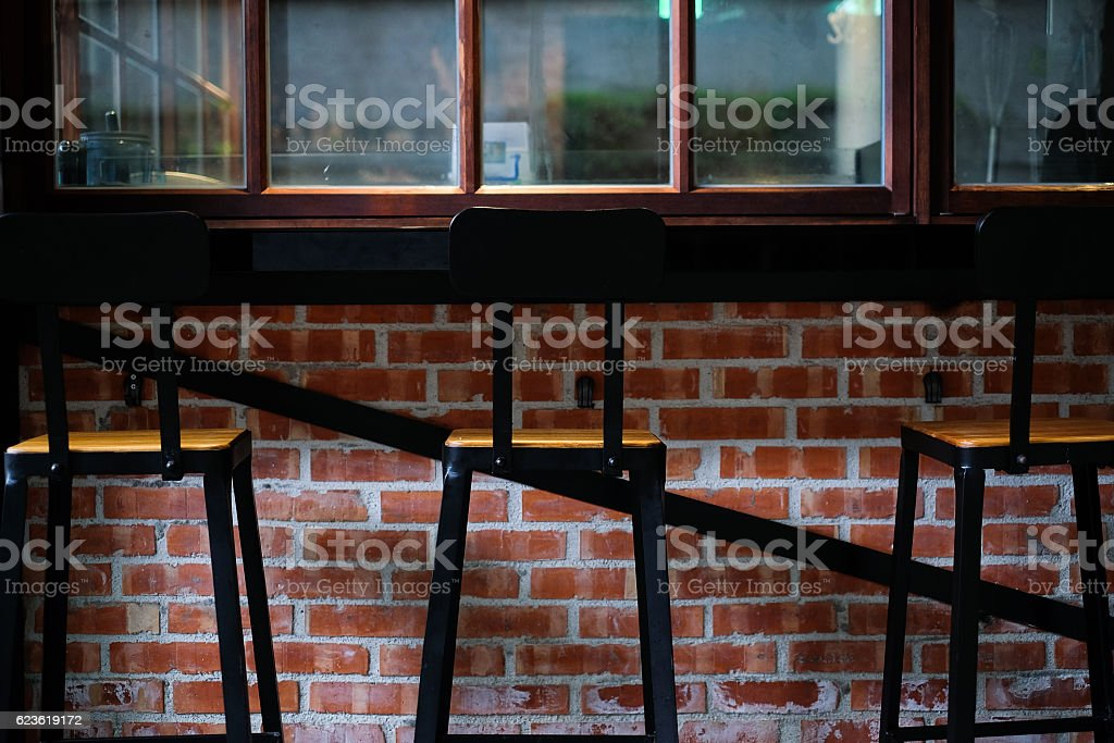 perspective wooden chair and table in bar stock photo