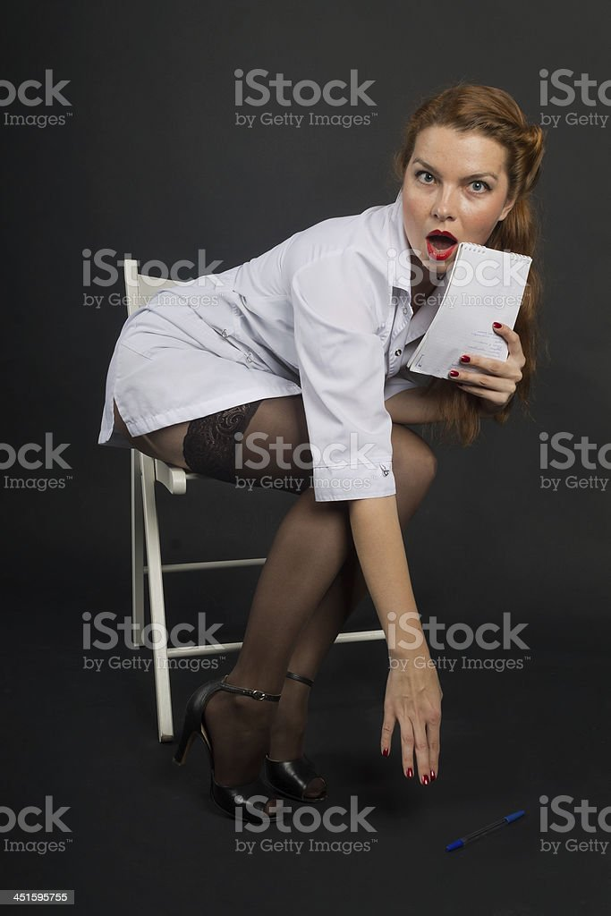perturbed nurse in pin-up raises the handle stock photo
