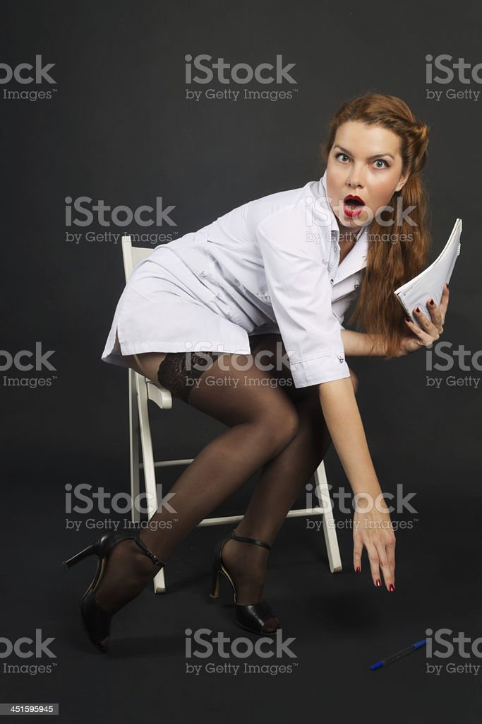 perturbed nurse in style 50th raises the handle stock photo