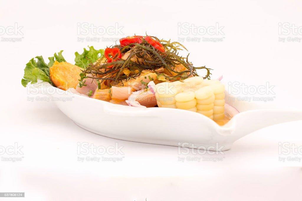 Peru Dish: Cebiche (ceviche) on 'sea urchin' sauce, with potato. stock photo