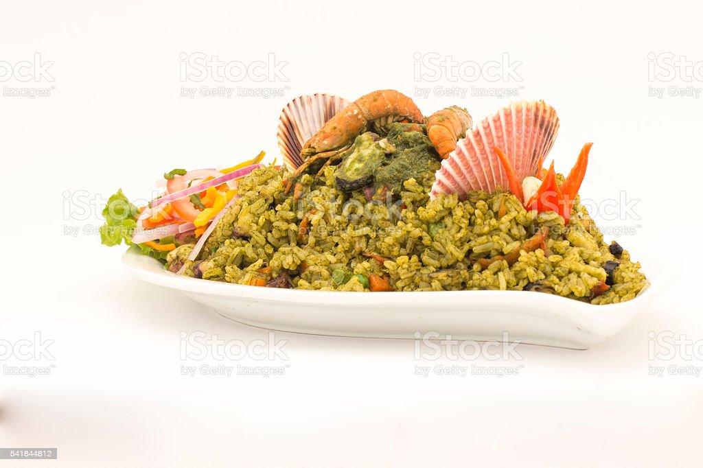 Peru  Dish: Seafood green rice made of rice, coriander, seafood. stock photo
