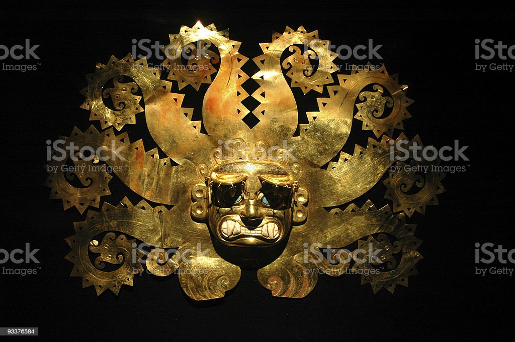 Peruvian ancient mask made out of gold stock photo
