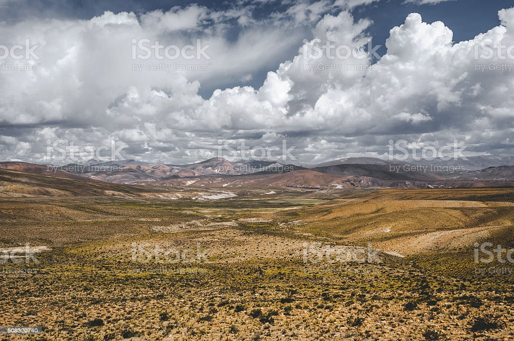 Peruvian Andes with big clouds stock photo