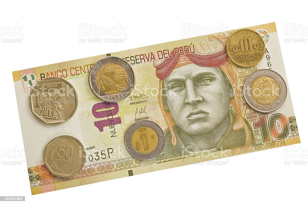 Peruvian banknote and coins. stock photo