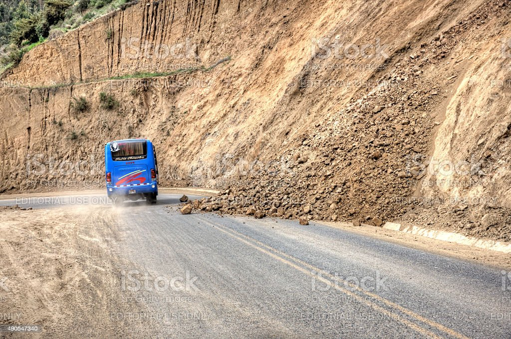 Peruvian bus avoiding Landslides on road in Peruvian Andes stock photo
