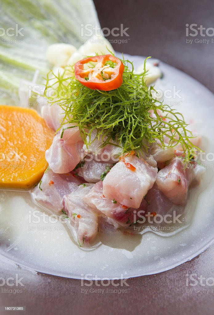 Peruvian ceviche topped with seaweed stock photo