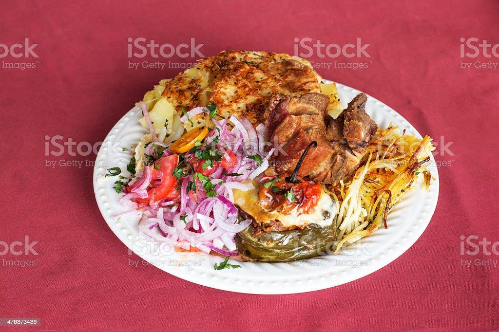 Peruvian Dish: Doble, Arequipa's plate: rocoto relleno, onion, smashed potatoes stock photo