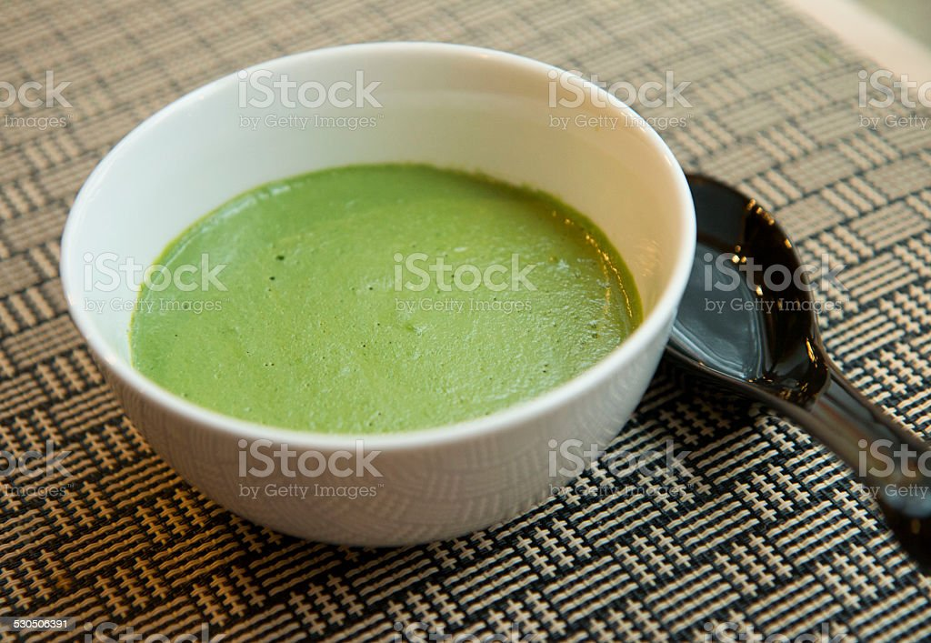 Peruvian green sauce with textured background stock photo