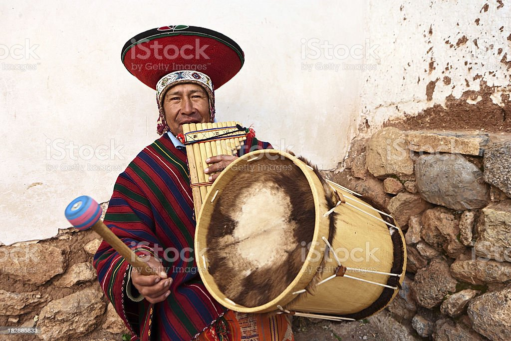 Peruvian man playing a panflute and drums, Sacred Valley stock photo
